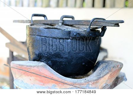 Black Pot And Firewood For Cooking In The North Of Thailand, Old Pot Black Color