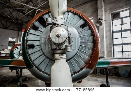Airplane screw close up in dark hangar