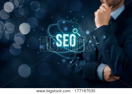 Search engine optimization - SEO concept. Businessman or programmer think how to improve SEO and web traffic.