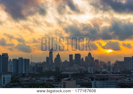 Sunrise scence of Bangkok Panorama Aerial view of Bangkok modern office buildings and condominium in Bangkok city downtown with sunrise sky and clouds at Bangkok Thailand. Silhouette of Bangkok skyline