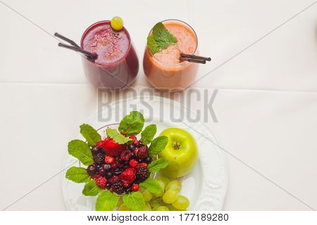 Healthy red smoothies and ingredients - superfoods detox diet health vegetarian food concept