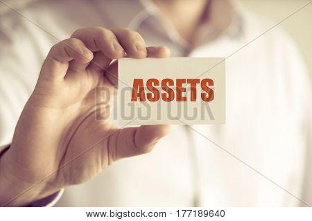 Businessman Holding Assets Message Card