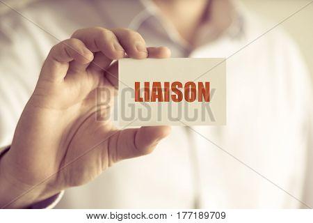 Businessman Holding Liaison Message Card