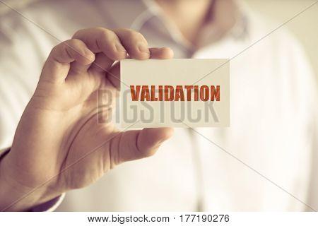 Businessman Holding Validation Message Card