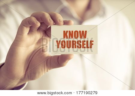 Businessman Holding Know Yourself Message Card