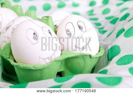 Easter Eggs With Funny Faces In The Green Box On Polka Dot Tablecloth. Emoji Funny Egg.