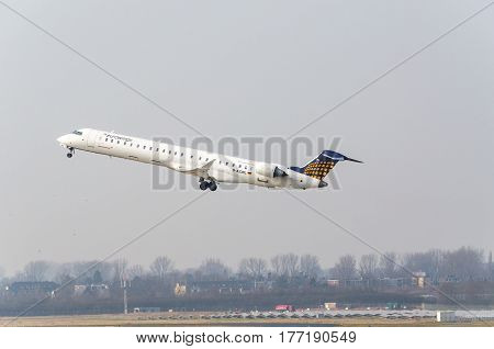 DUESSELDORF NRW GERMANY - MARCH 18 2015: Euro Wings Canadair Regional Jet at startup on the Dusseldorf airport.