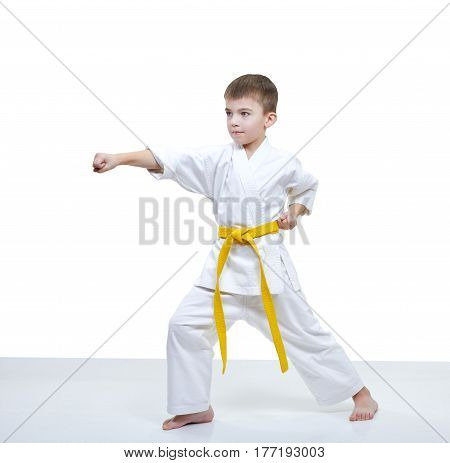 On a white background boy beats punch arm