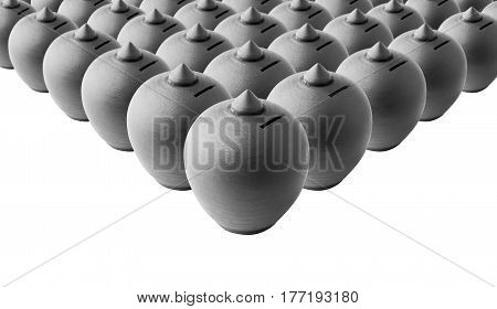 Typical terracotta money saving box or piggy bank arranged in group, selective focus, black and white