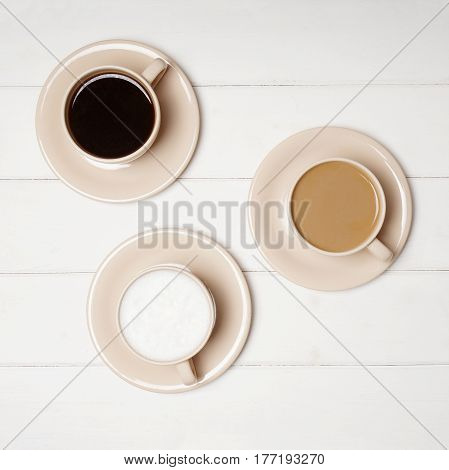 top view of selection of different coffee drinks in cups. black, flat white and cafe latte.