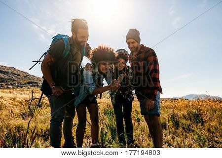 African Female With Friends Taking Pictures In Countryside