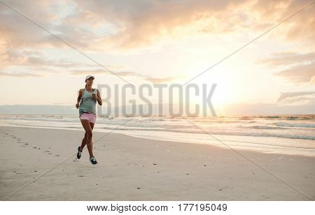 Fit Woman Running On The Beach In Morning