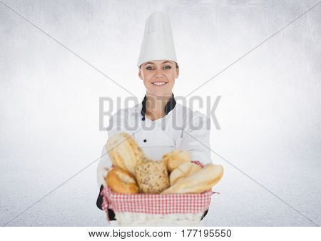 Digital composite of Chef with bread against white background