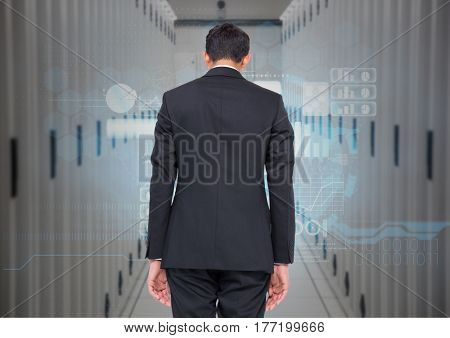 Digital composite of a Businessman back view Standing looking at Graphic