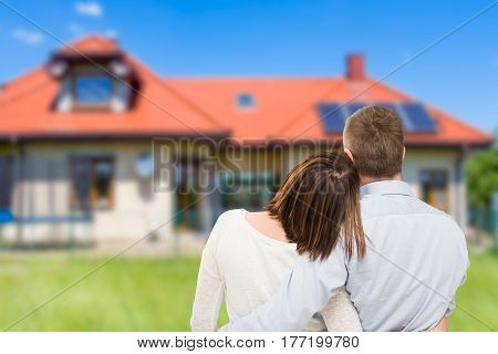 Loving young couple looking at dream house.