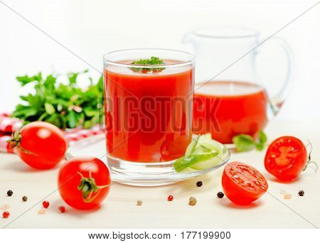 Tomato Juice In Glass, Jug With Greenery, Basil, Cutted Tomato Fruit And Dry Pepper On Light Table,
