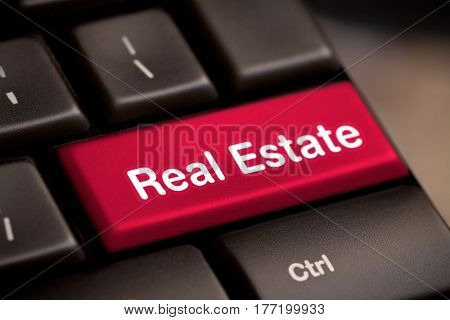 Computer keyboard with real estate key- stock image.