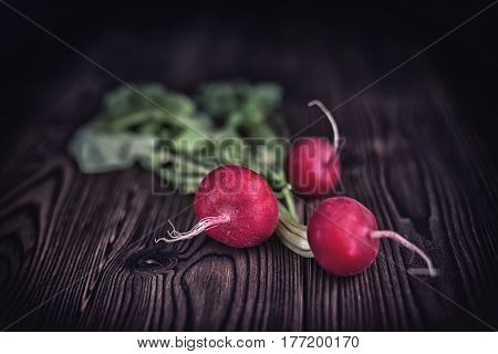 Fresh Radishes On Old Rustic Wooden Table Background, Dark Toned Style, Close Up