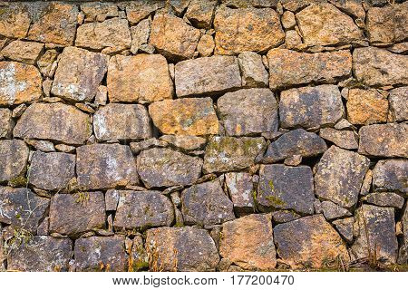 old weathered stone brown wall background in India close up