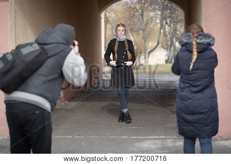 Photographers Work With A Model On The Street