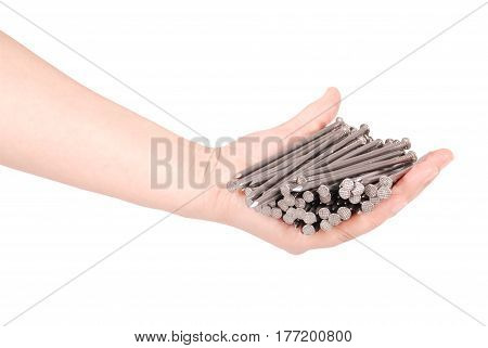 Man's hand holding metal nails. Closeup with clipping path isolated on white background