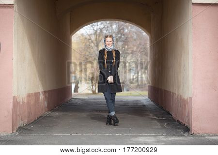 Beautiful Red-haired Girl In The Arch Of The House