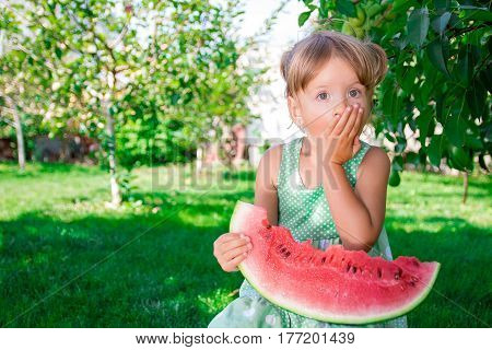 Little Blonde Girl With Big Slice Watermelon In Summer Time In Park, Outdoor. Surprise Child. Oops,