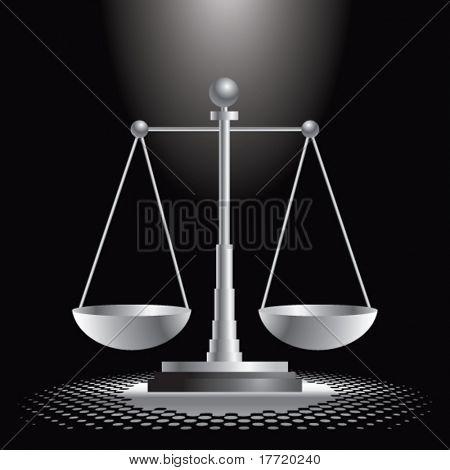 justice scales under spotlight