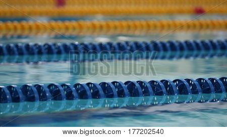 Swimming pool track markers empty low angle view close to