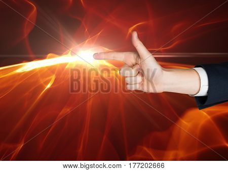 Digital composite of Hand as a gun with a flame at the top of the finger against black background