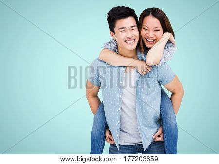 Digital composite of happy Asian couple against blue background