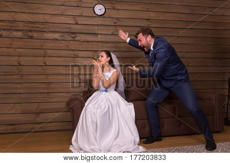Portrait of wife doing makeup, husband shouting