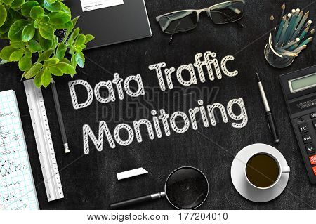 Data Traffic Monitoring Handwritten on Black Chalkboard. Top View Composition with Black Chalkboard with Office Supplies Around. 3d Rendering. Toned Illustration.