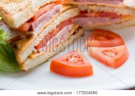 sandwich with cheese, tomato and smoked meat, rustic