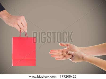 Digital composite of Hands offering Gift against grey background