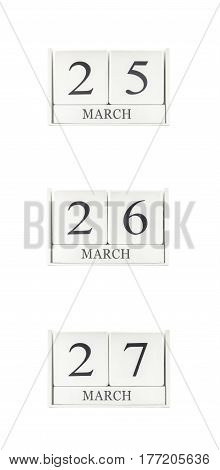 Closeup group of white wooden calendar with black 25 26 27 march word three date calendar isolated on white background