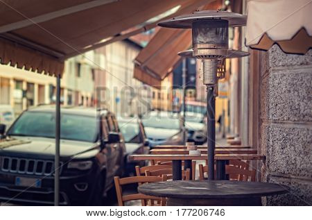 Gas heater patio heater mushroom heater umbrella heater. Tables for eating outdoors.