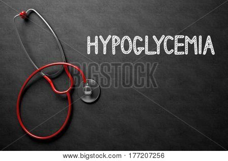 Hypoglycemia Handwritten Medical Concept on Chalkboard. Top View Composition with Black Chalkboard and Red Stethoscope on it. Medical Concept: 3D Rendering.