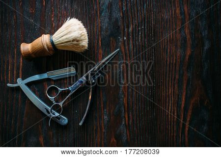 Shaving and barber equipment on wooden background