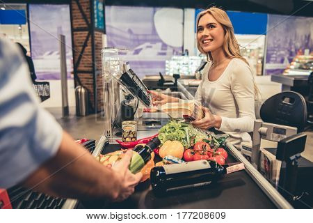Female Worker At The Supermarket
