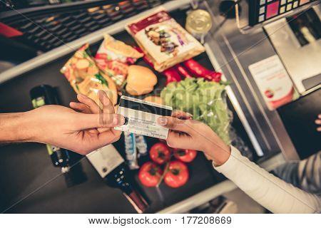 At The Supermarket Cash Desk