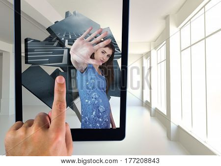 Digital composite of Hand Touching tablet screen with virtual reality