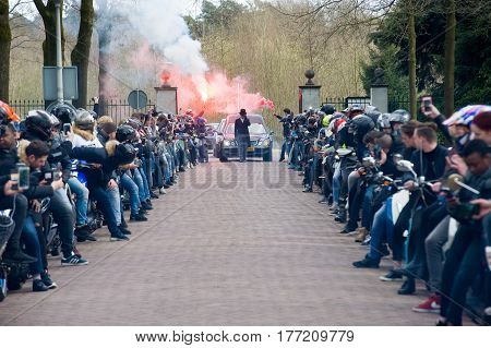 ENSCHEDE THE NETHERLANDS - MARCH 17 2017: Members of a motor gang making a lane during a funeral procession. It is a tribute because one of their members perished in a crash.