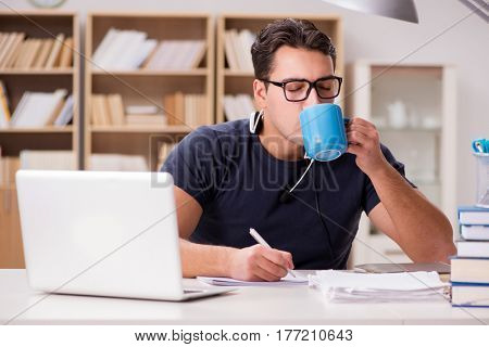Young student drinking coffee from cup