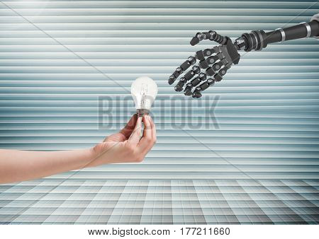 Digital composite of human hand giving lightbulb to robot hand against striped background