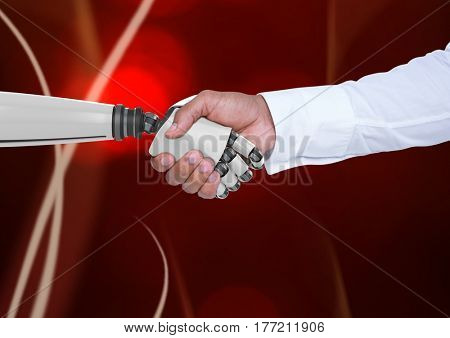 Digital composite of Handshake between robot and human against red background