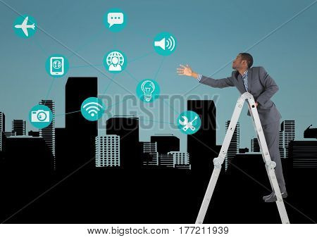 Digital composite of Businessman on a Ladder trying to catch his objectives against city view