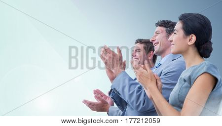 Digital composite of people Clapping and smiling against blue background