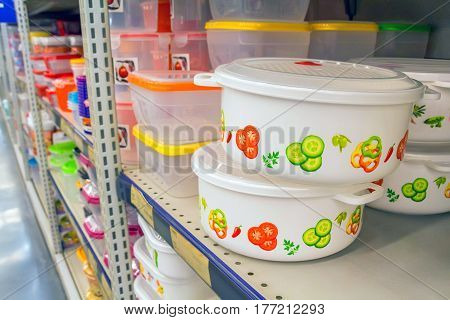 Plastic tableware on shelf in the shop