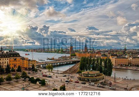 Scenic aerial view of Gamla Stan - Old Town - and Slussen in Stockholm Sweden with picturesque sunset sky